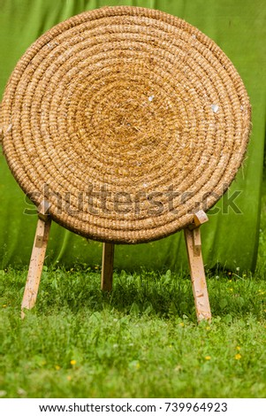 Sport competitions equipment concept. Old fashioned shooting target made of hay on wooden legs #739964923