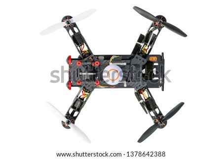 Sport copter. Dron, quad copter Isolated on white background. Remote controlled dron, quadro copter with digital camera. Closeup. New tool for aerial photo and video. Foto stock ©