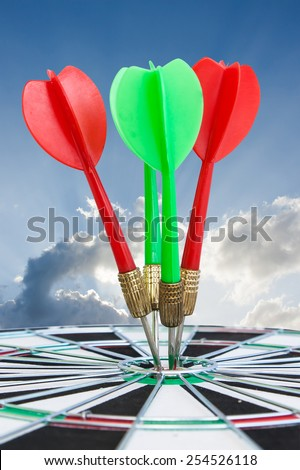 Sport Dart go to target and success on blue sky background