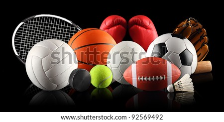 sport equipment and balls in front of black background #92569492