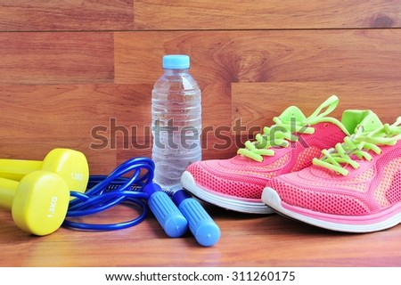 Sport equipment on wooden floor.
