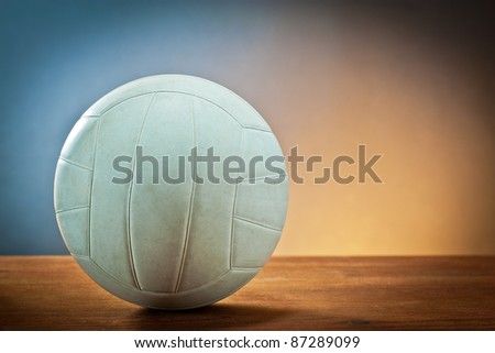 Sport equipment. Volleyball on wood.