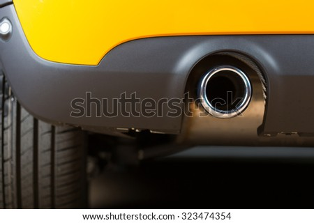 Sport exhaust in a car stopped orange