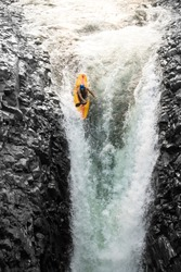 sport extrem kayak raft water white danger waterfall rapid courage courageous kayaker in a vertical diving position sport extrem kayak raft water white danger waterfall rapid courage color colour fast