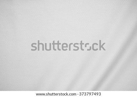 Sport fabric texture. Soccer shirt texture. Textile texture. Sport uniform texture. Modern fabric texture. Luxury fabric texture. Jersey fabric. Mesh fabric texture. Shirt background. Rough material.