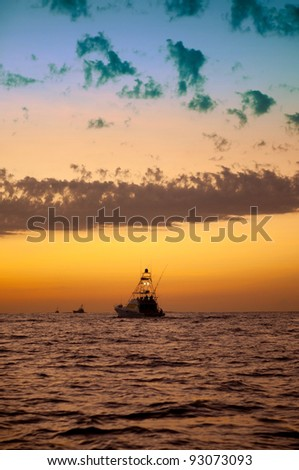 Sport fishing boats heading out just before sunrise for a day of fishing.