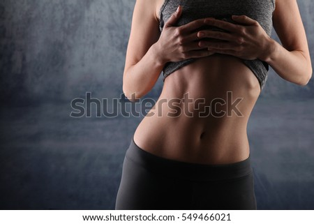 Shutterstock Sport, fit woman. Female with perfect abdomen muscles on grey background. Dieting, fitness, active lifestyle concept, copy space