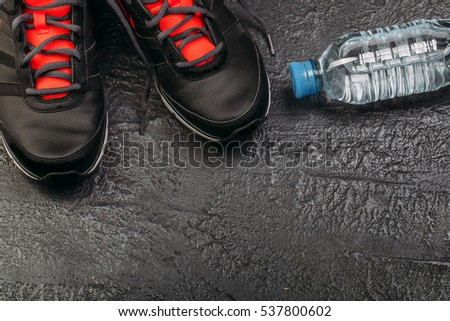 Sport flat lay composition with sneackers on black background. Concept special for healthy lifestyle and sport. Fitness equipment #537800602