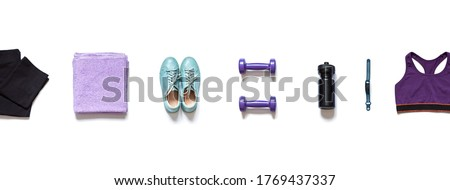 Sport flat lay with sportswear, a shaker, dumbbells on the white background. Home training concept banner.   Foto stock ©