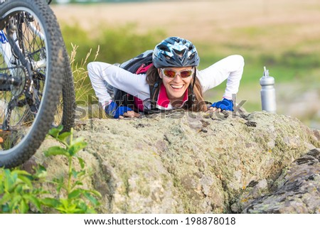 Sport funny bike woman on a mountain with a beautiful landscape