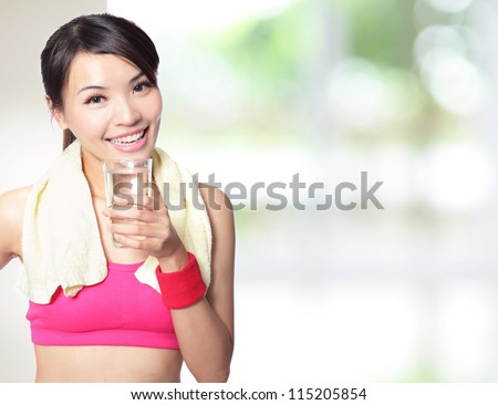sport girl drinking water after sport with nature green background, model is a asian woman