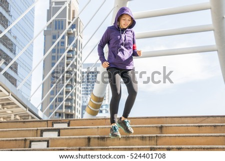 Sport girl is jogging morning exercise in the city. #524401708