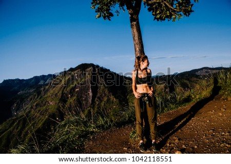 Sport girl on the top of the mountain  #1042118551