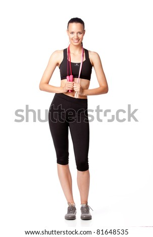 Sport girl with jumping rope - stock photo