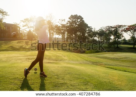 Sport, Golf , People concept - Asian woman golfer hit sweeping golf course in the summer. Asian woman looking enjoy to play golf sport.