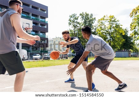 sport, leisure games and male friendship concept - group of men or friends playing street basketball #1514584550