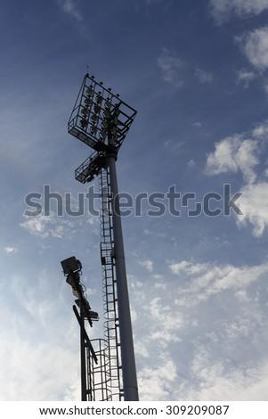 sport light of football stadium with blue sky