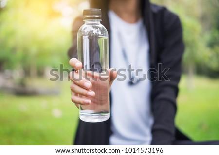 Sport man drinking water bottle.