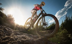 Sport. Mountain Bike cyclist riding single track.