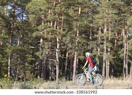Sport mountain biking happy couple riding downhill in sunny countryside