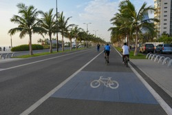 Sport public bicycle and pedestrian track or lanes beside the road in Jeddah new modern beach in Saudi Arabia. (bicycle icon)