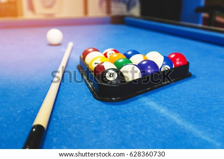 Sport, recreation, game, competition - Playing billiard. Billiards balls an cue on billiards table. Billiard sport concept. Pool billiard game.