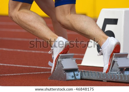 sport - runner at starting block in running competition