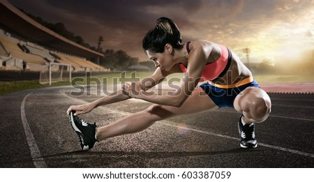 sport. runner stretching on the ...