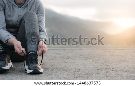 Sport runner woman tying laces before training. Marathon. Concept Sports and recreation.  #1448637575