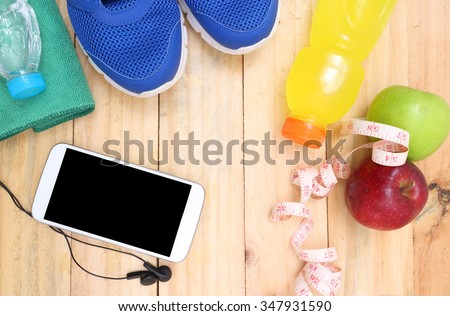 Sport shoes and water with set for sports activities on tiled floor.sports, fitness, concept of weight loss