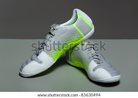 Sport shoes on gray background. Close up.