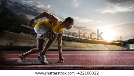 Sport. Sprinter leaving starting blocks on the running track.