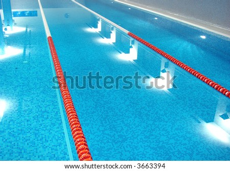sport swimming pool  with path lanes and blue water  (from left)
