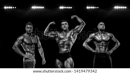 Sport wallpaper and motivation concept. Strong athletic bodybuilder at gym on black background. Fitness and bodybuilding nutrition ad poster.