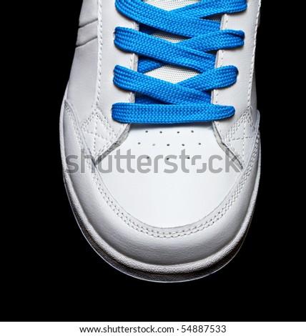 Sport white shoe isolated on black background