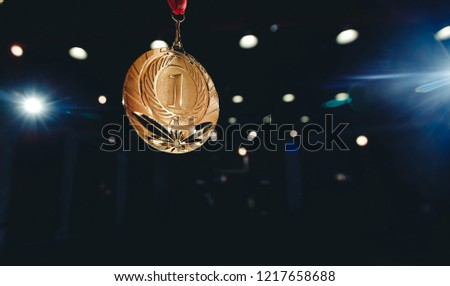 Sport winner gold medal first place in competitions dark background #1217658688