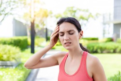 Sport woman gets dizzy and faint when she jogging or exercise outdoor with strong sunlight in summer season. She will be fainting after exercise. Beautiful girl get heatstroke