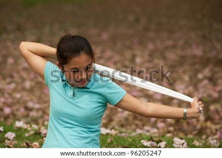 Sport woman of Thai with towel in the park.