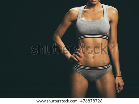Sport. Woman sport body strong and beautiful #476878726