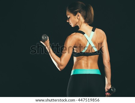 Sport. Woman sport body strong and beautiful. Back view.  #447519856