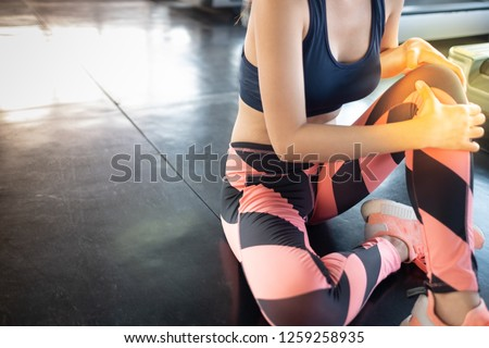 Sport Women exercise fitness and injury leg or knee accident at gym fitness, bone broken, filling hurt and painful during training gymnastics.