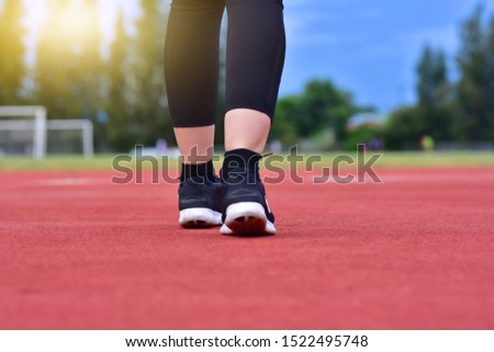 Sport women running jogging on road Sunlight energy feet jog legging shoe recreation Sportswoman Street on activity nature outside sunset, marathon female action endurance in city lifestyle healthy