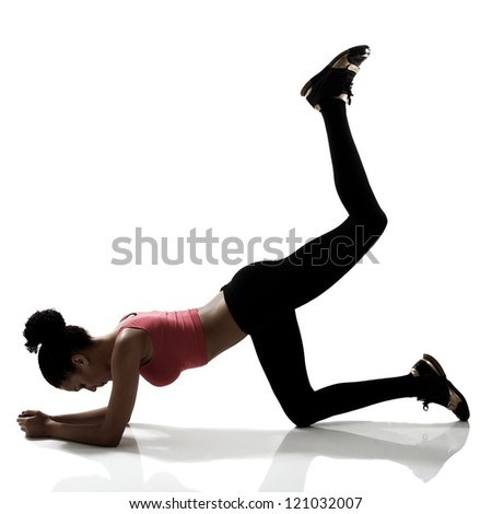 sport young athletic woman doing legs exercise, active fitness girl silhouette studio shot over white