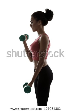 sport young woman doing exercise with dumbbells, fitness girl silhouette studio shot over white background