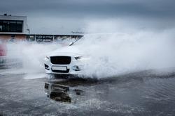 Sportcar riding through the rain