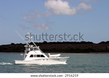 sportfisherman boat on crystal clear blue tropical waters