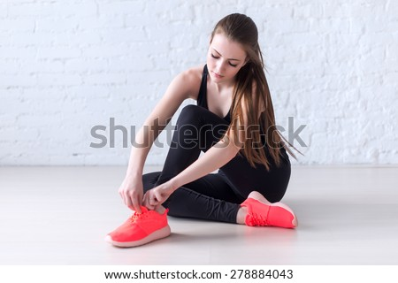 Sportive active girl lacing trainers sports shoes tie shoelaces. ストックフォト ©