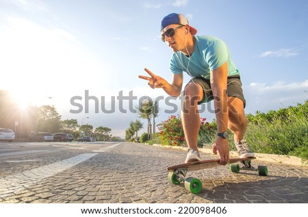 Sportive cool an on a skateboard - cool street skateboarder in a urban setting - fashion,sport,lifes tyle concept