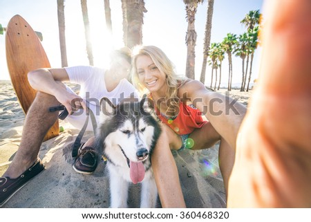 sportive couple with husky...