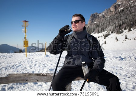 sportive man on the mountain trek, man sit and rest